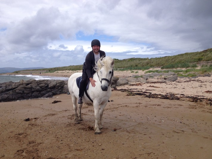 Bonding with Magnus the horse on Blackwaterfoot beach, as part of a Cairnhouse Riding Centre trek. Photo: Dawn MacAlister